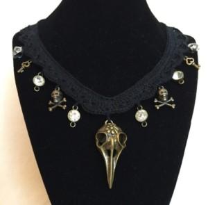 Goth bird skull necklace in black