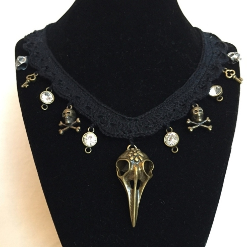 Goth bird skull necklace in black