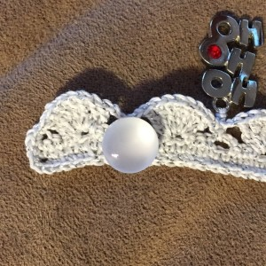 How to add a button to a crochet bracelet
